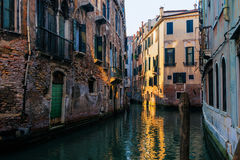 Traditional buildings on the canal of Venice, Italy. Stock Photo