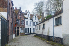 Traditional buildings and cobbled street Bruges, Belgium Stock Photos