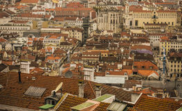 Traditional buildings, Lisbon, Portugal. A view of a street with some traditional old buildings in Lisbon, Portugal. There are some red-tiled roofs and crossing Royalty Free Stock Image