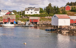 Traditional buildings in the Norwegian fishing bay. Royalty Free Stock Images