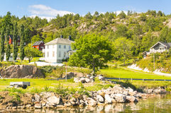 Traditional buildings of Norwegian, Norwegian village on the fjo Royalty Free Stock Images