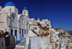 Traditional buildings in Oia village Stock Images