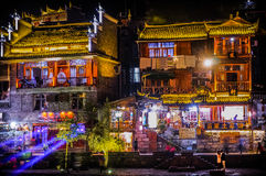Traditional buildings on waterfront at night in Fenghuang (Phoen Royalty Free Stock Images
