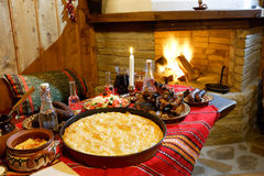 Traditional Bulagrian food in front of a chimney royalty free stock images