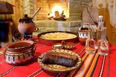 Traditional Bulagrian food on table. Traditional Bulgarian food on table in front of open fire stock photos