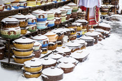 Traditional bulgarian clay pots covered with snow. Colorful bulgarian clay pots in souvenir shop in Sofia ,Bulgaria Stock Image