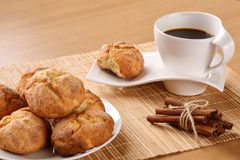 Traditional bulgarian cookies, called kurabiiki, cup of coffee and tied cinnamon sticks on a beige bamboo table mat. Shallow depth Stock Photos