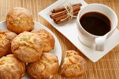 Traditional bulgarian cookies, called kurabiiki, cup of coffee and tied cinnamon sticks. Warm and delicious autumn breakfast Royalty Free Stock Images