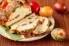 Traditional bulgarian Easter breakfast with homemade Easter cake and colored eggs. Traditional bulgarian Easter cake `kozunak` with raisins, nuts and turkish Stock Photo