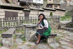 Traditional Bulgarian Folklore. A beautiful young woman in folklore costume shot in the old village of Leshten, Bulgaria stock photography
