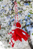 Traditional bulgarian martenitsa on a blooming spring tree Stock Image