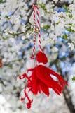 Traditional bulgarian martenitsa on a blooming spring tree. Martenitsa, Pizho and Penda.bulgarian spring custom Stock Image