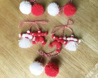 Traditional bulgarian red and white martenitsa from wool. Martenitsa with smiley face .bulgarian spring custom Stock Images