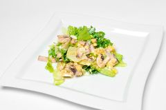 Salad with greens, ham, eggs, tomatoes on a white background. isolate stock photography