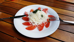 Traditional bulgarian shopska  salad. Traditional bulgarian Tomato salad  with cheese in a restaurant Royalty Free Stock Photo