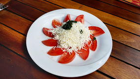Traditional bulgarian shopska  salad. Traditional bulgarian Tomato salad  with cheese in a restaurant Royalty Free Stock Image