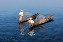 Traditional Burmese fishermen at lake, Myanmar Stock Photos