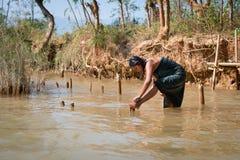 Traditional Burmese washing in lake water Stock Photo