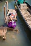 Traditional Burmese washing in lake water Stock Images