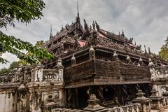 Traditional Burmese wooden architecture in the Pariyahti State University campus, Mandalay, Myanmar royalty free stock image