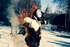 The traditional burning of the effigy of Maslenitsa. Traditional burning effigy of Maslenitsa at the end of winter holiday stock image