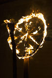 Traditional burning fiery wheel in Slavic celebration of the winter solstice Stock Photos