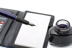 Traditional business concept pen, ink ink in the bottle Stock Photography