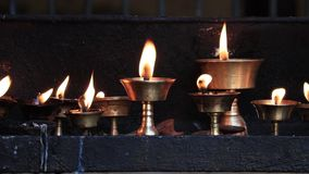 Traditional butter lamps stock video footage