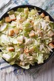 Traditional Caesar salad close-up on a plate. vertical top view Royalty Free Stock Image