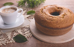 Traditional cake and a cup of milk with coffee   Grandmother cake Stock Images
