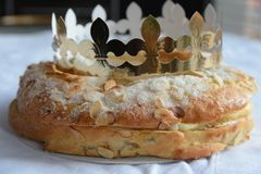 Traditional cake named Roscoe de Reyes in Spain. A delicious cake with a surprise hidden inside in  Spain's annual Three Kings Festival Fiesta de los royalty free stock photos