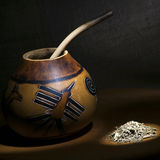 Traditional calabash gourd with bombilla and yerba mate Royalty Free Stock Image