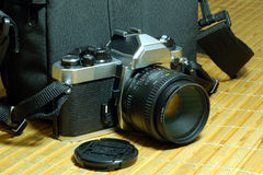 Traditional camera and camera bag Royalty Free Stock Photography