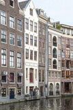Traditional canal houses in Amsterdam, Netherlands Stock Images