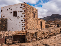 Traditional Canary Islands Farm House. Traditional Canary Islands farmhouse, with a dog sleeping outside. La Alcogida Ecomuseum in Fuerteventura, Canary Islands Stock Photos