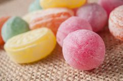 Traditional candies on hessian background. Closeup of traditional candies on hessian background stock photos