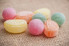 Traditional candies on hessian background. Closeup of traditional candies on hessian background stock images