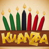 Traditional Candles over a Ribbon with Golden Text for Kwanzaa, Vector Illustration Stock Photo