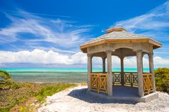 Traditional Caribbean arbor on shore Stock Image