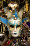 Traditional carnival mask in Venice. Sold in the streets everywhere, a symbol of Venice, a good souvenir or present Royalty Free Stock Photo