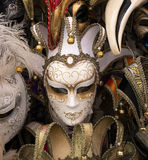 Traditional carnival mask in Venice. Traditional white carnival mask in Venice, sold in the streets everywhere, a symbol of Venice, a good souvenir or present Royalty Free Stock Images