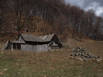 Traditional Carpathian old cottage house. A traditional Carpathian old cottage house used lived from the spring till the autumn by the villagers who grow animals Royalty Free Stock Photos