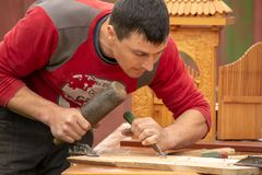 Traditional carpenter close up working hands with carpeting tools. stock photos