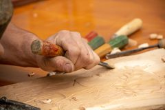 Traditional carpenter close up working hands with carpeting tools. stock photography