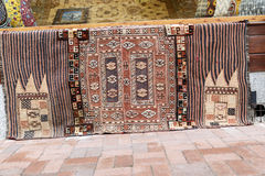 Traditional carpets in street,Istanbul. Royalty Free Stock Images
