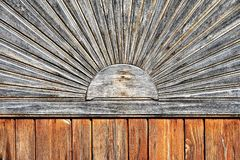 Traditional carved sun motive. On a hungarian wooden fence royalty free stock image