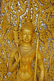 Traditional carved wooden door at Wat Tha Sung temple in Uthai Thani, Thailand. Beautiful traditional carved wooden door at Wat Tha Sung temple in Uthai Thani Stock Photo