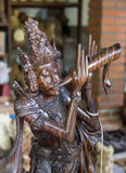 Traditional carved wooden sculpture of the Bali Stock Photo