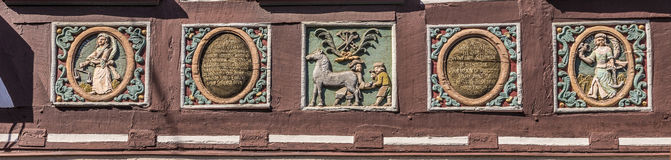 Traditional carving at an half timbered house with symbols Royalty Free Stock Photography