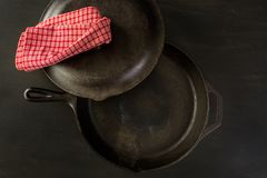 Skillet. Traditional cast iron skillet on black wood table Stock Photo